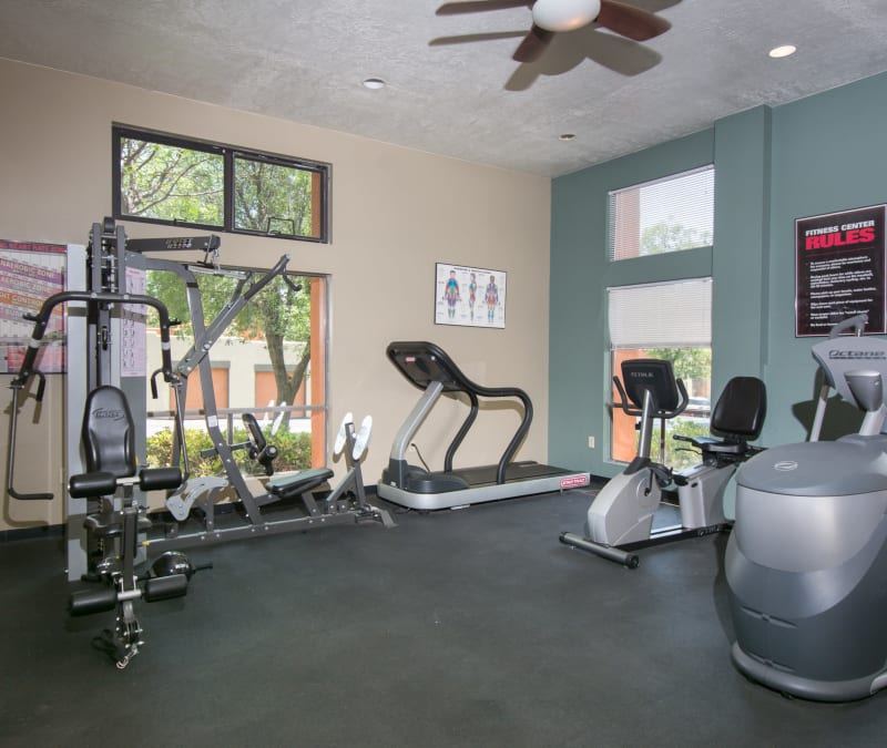Fitness center with individual workout stations at Mesa Del Oso in Albuquerque, New Mexico