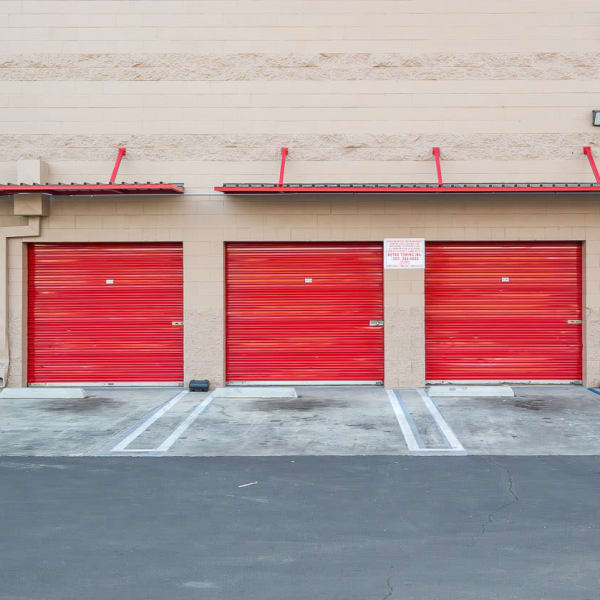 Outdoor storage units with red doors at StorQuest Self Storage in Los Angeles, California