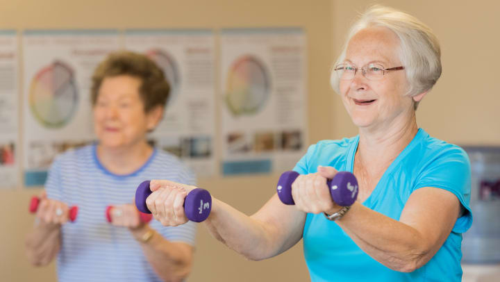 Image of Touchmark residents lifting weights.