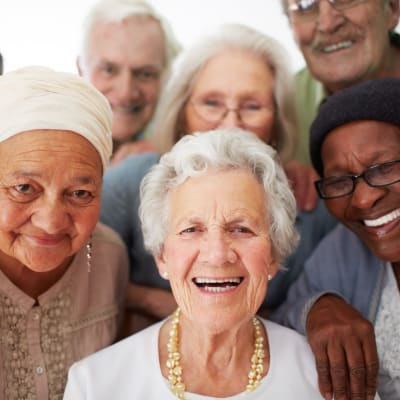 A diverse group of residents at AgeWell Living