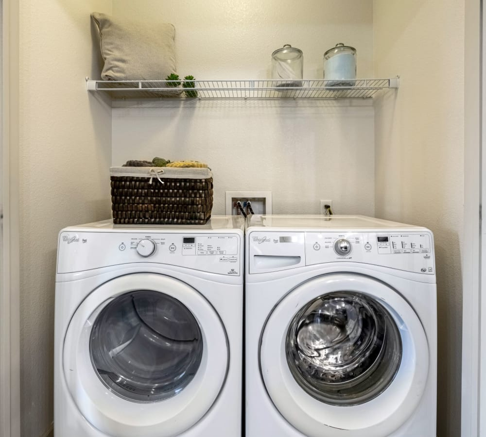 In unit front loading washer and dryer in an apartment at The Parc at Greenwood Village in Greenwood Village, Colorado