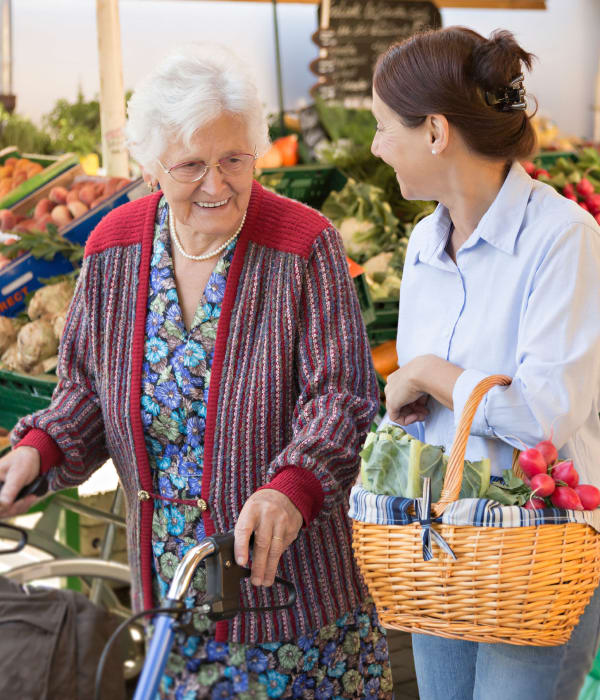Resident and caretaker shopping at the grocery store near The Retreat at Carolina Bay in Hartsville, South Carolina