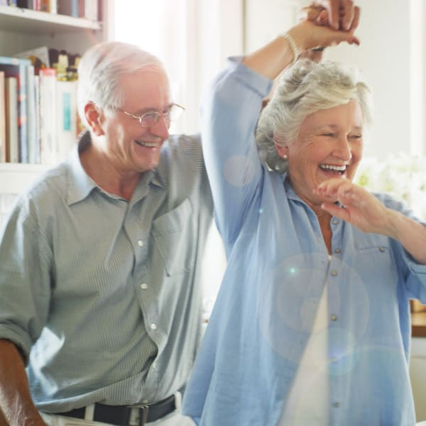 Residents dancing at Chesapeake Place Senior Living in Chesapeake, Virginia.