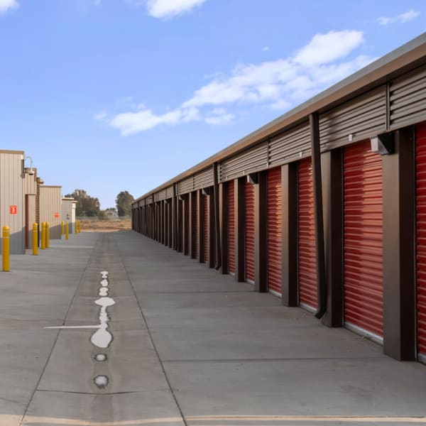Outdoor storage units with red doors at StorQuest Self Storage in Fresno, California