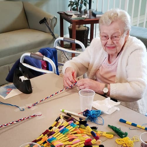 A resident crafting at Canoe Brook Assisted Living & Memory Care in Catoosa, Oklahoma