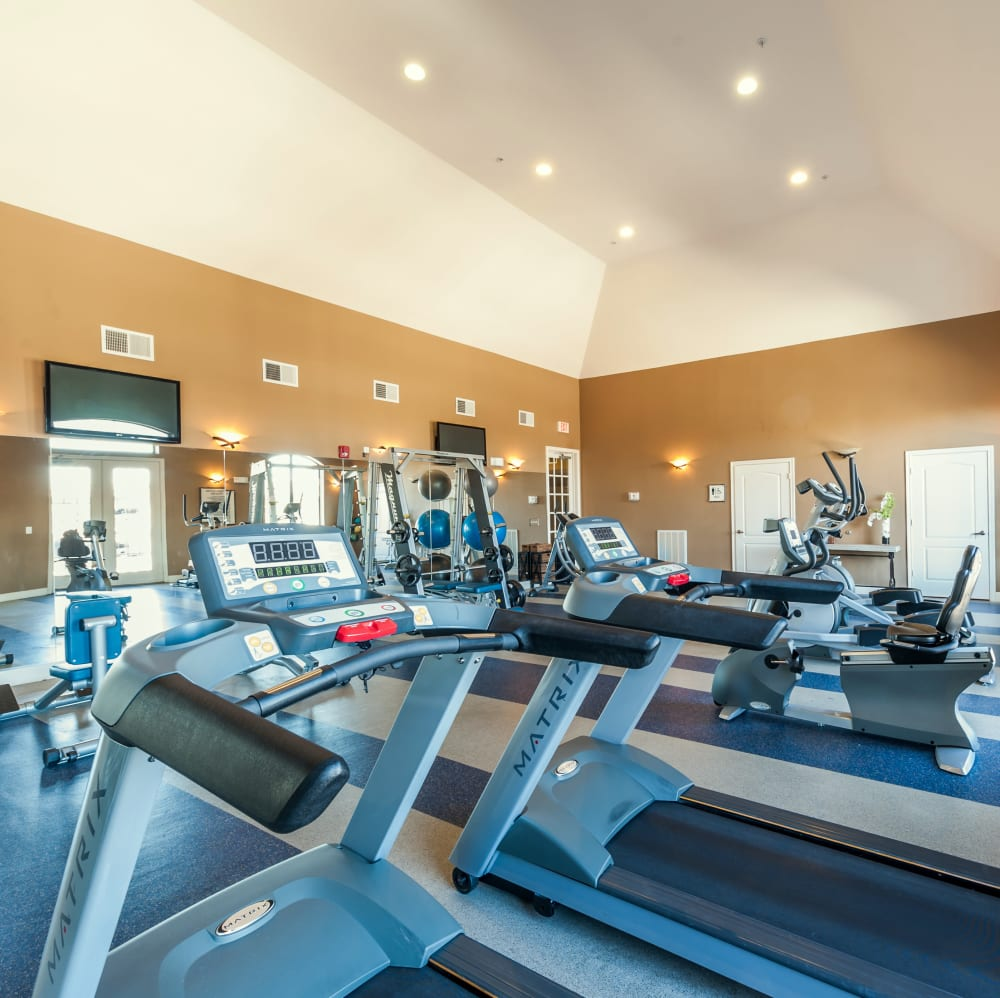 Fitness center with individual workout stations at The JaXon in Kingwood, Texas