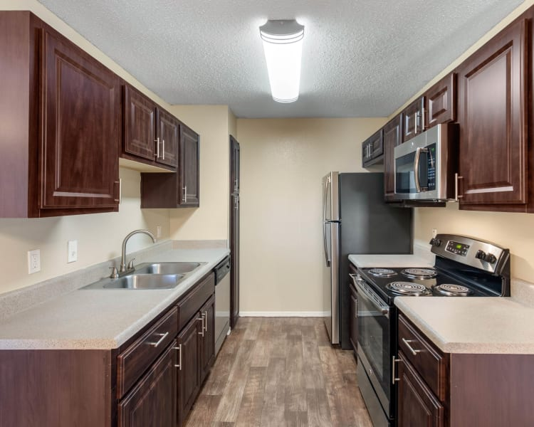 Spacious kitchen with plenty of counter space at The Logan in Bedford, Texas