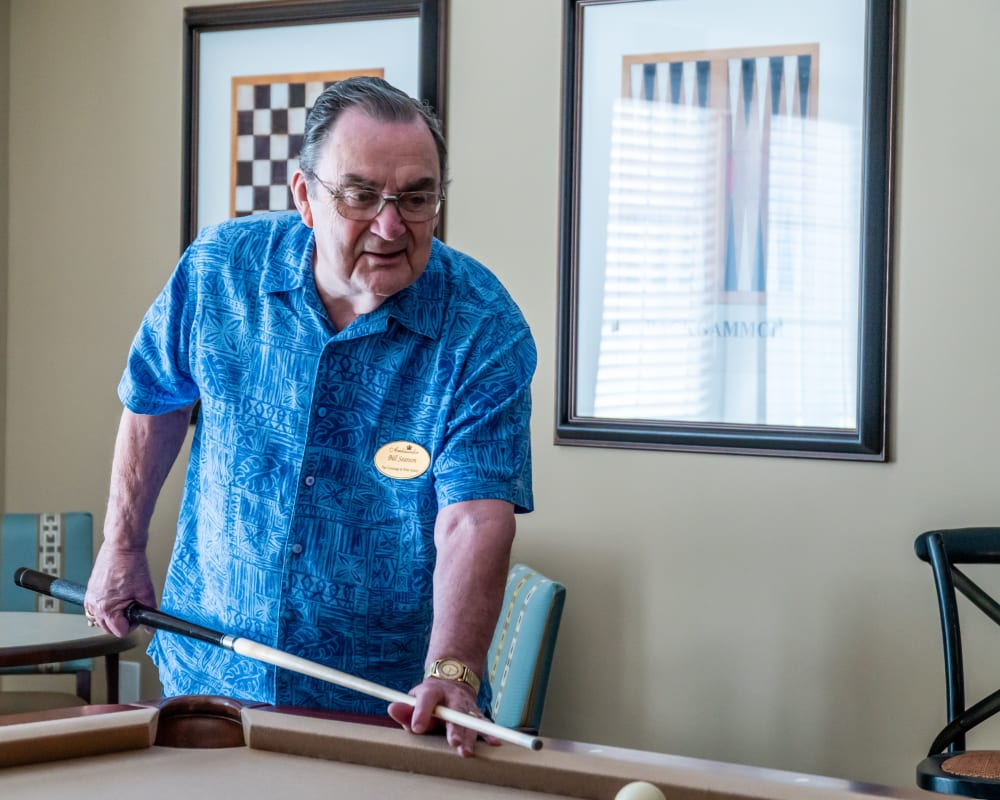 A resident plays pool at Harmony at West Ashley in Charleston, South Carolina
