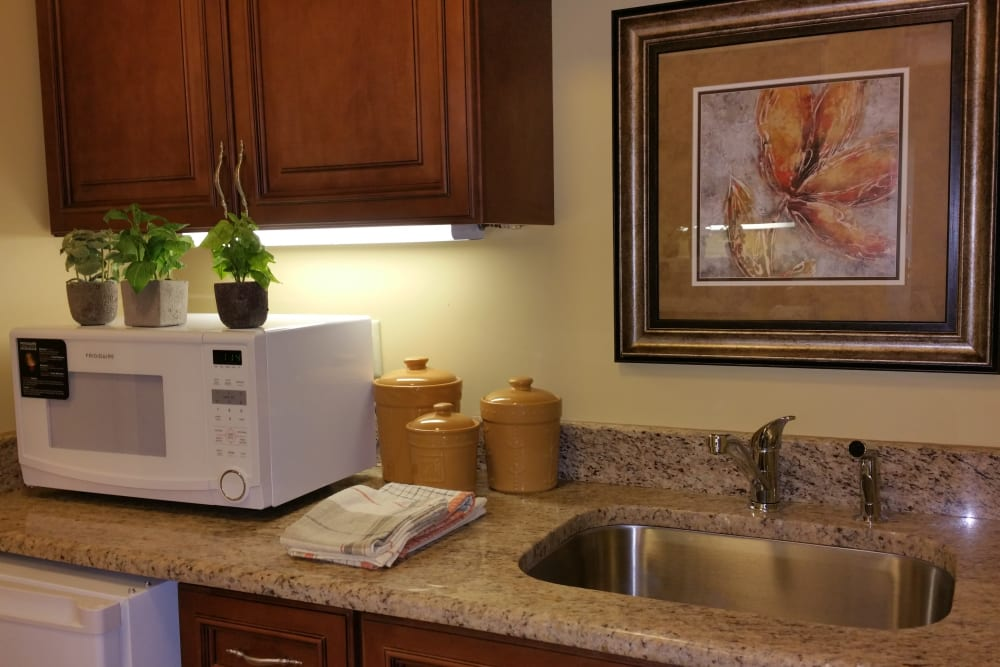 An apartment kitchen at Gentry Park Orlando in Orlando, Florida