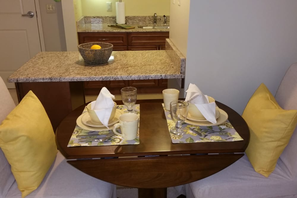 A set dining room table in an apartment at Gentry Park Orlando in Orlando, Florida