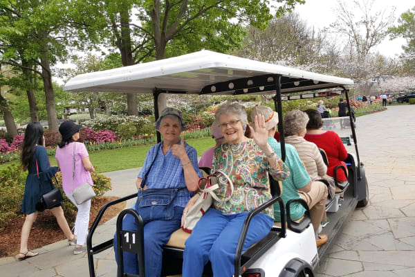 Residents from Liberty Heights Gracious Retirement Living in Rockwall, Texas on a golf cart