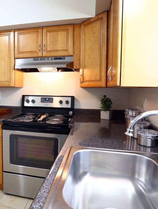 Kitchen with stainless-steel sink at Orchard Hills Apartments in Whitehall, Pennsylvania