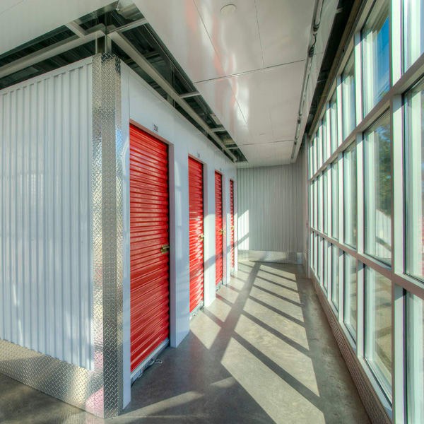 Red doors on indoor units at StorQuest Self Storage in Clearwater, Florida