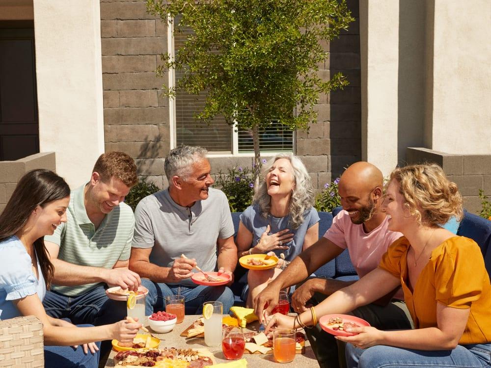 Residents enjoying food and drinks outside at BB Living at Val Vista in Gilbert, Arizona