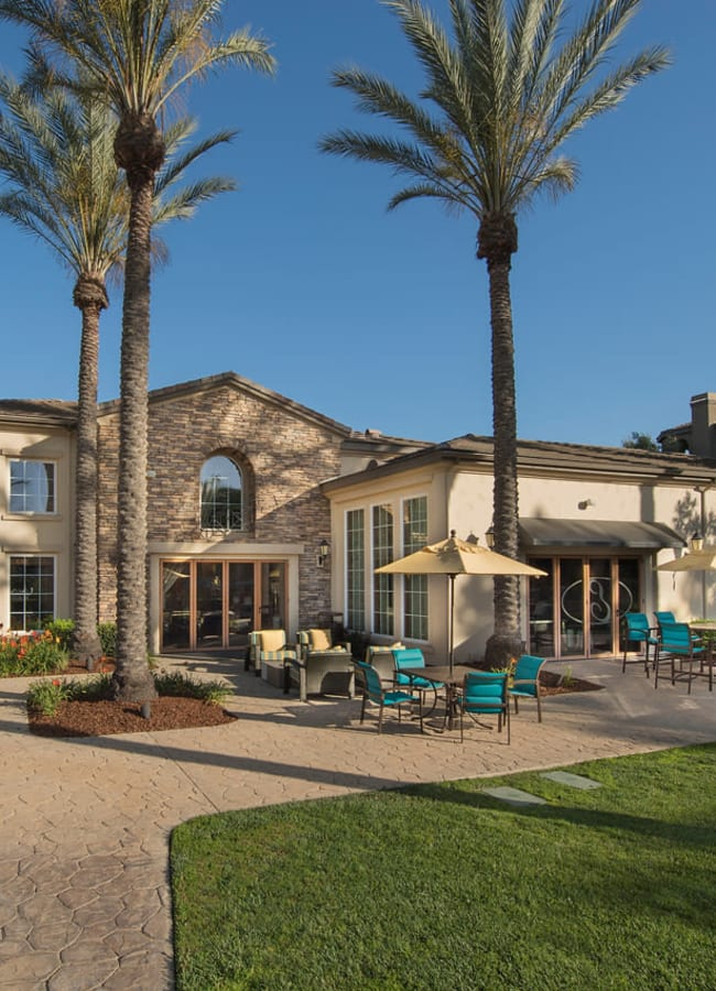 Back clubhouse deck with seating at Esplanade Apartment Homes in Riverside, California