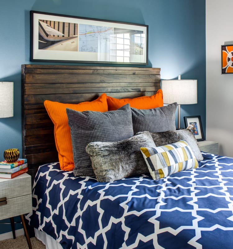 Colorfully decorated bedroom with an accent wall in a model home at Sofi at Cedar Mill in Portland, Oregon