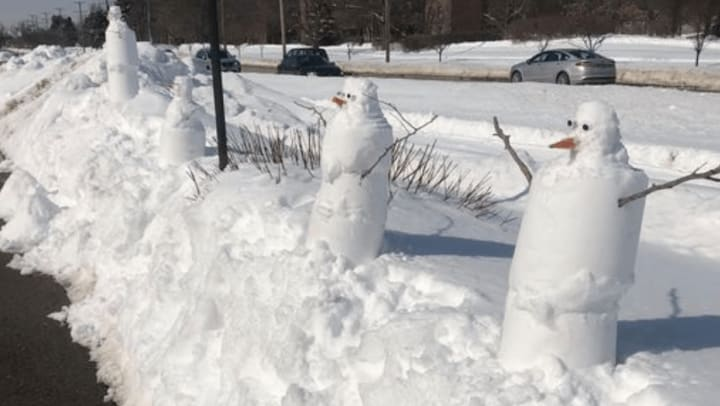 """Snow People """"Village"""" for Emerald Place Residents"""