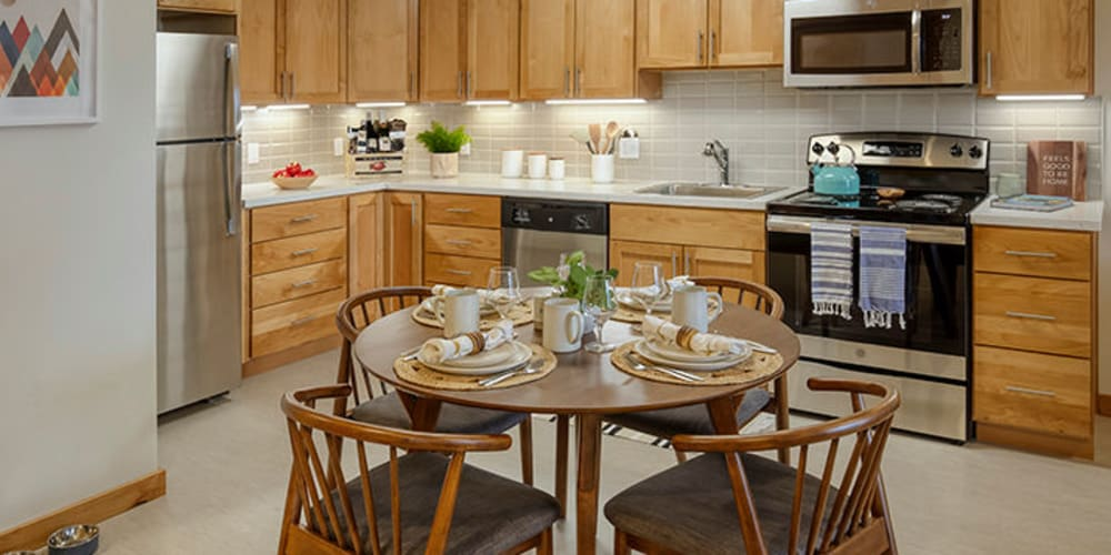Charming kitchen in senior apartment with wood detailing at The Springs at Sherwood in Sherwood, Oregon