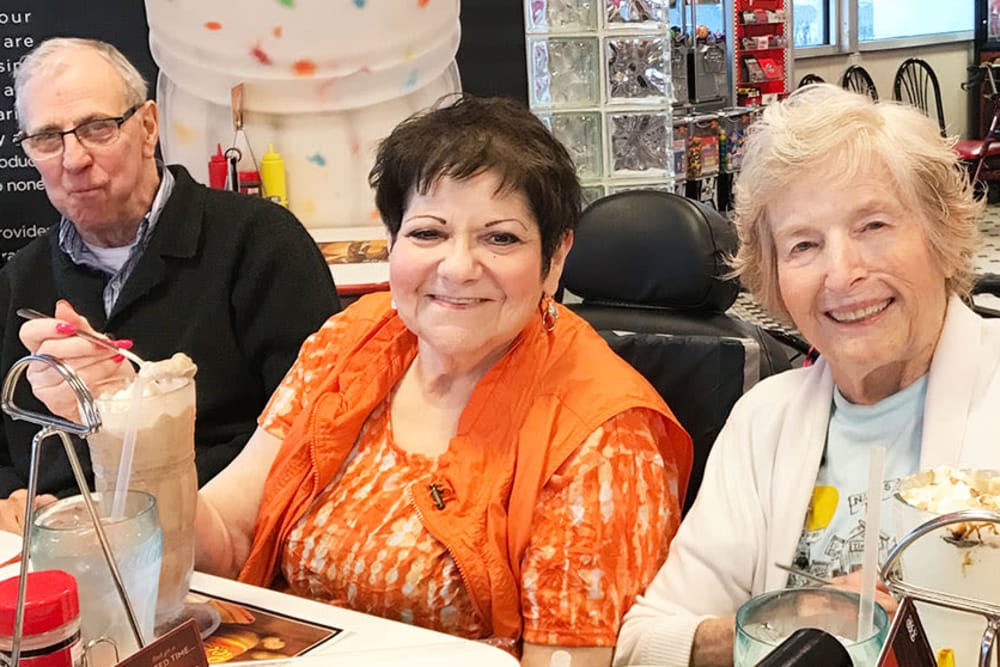 senior residents enjoying milk shakes