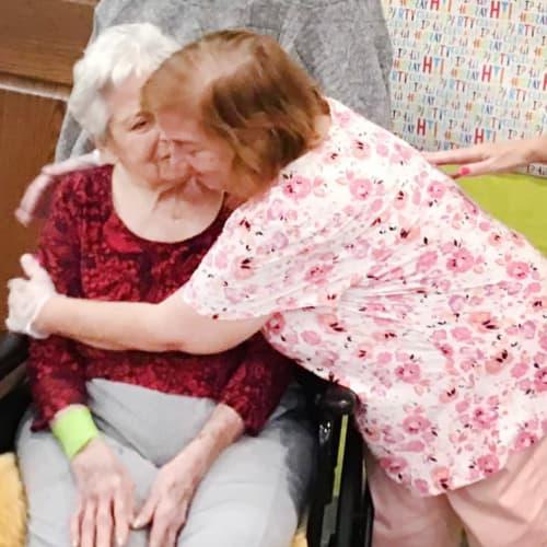 Residents hugging at Oxford Glen Memory Care at Grand Prairie in Grand Prairie, Texas