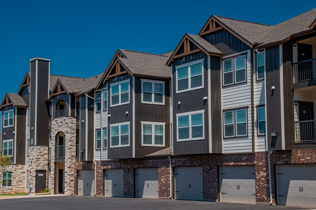 Beautiful building with attached garages at Stonehorse Crossing Apartments in Oklahoma City, Oklahoma
