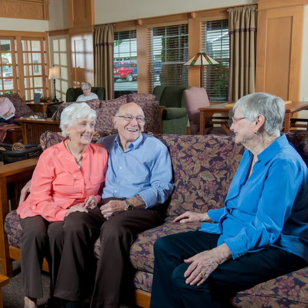 Residents laughing and talking at The Springs at Clackamas Woods in Milwaukie, Oregon