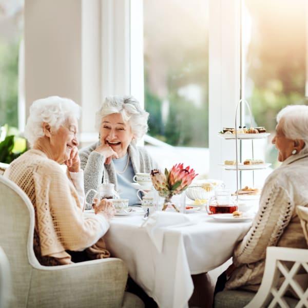 Resident friends dining at Monte Vista Village in Lemon Grove, California.