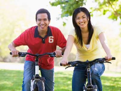 Couple riding bikes near Liberty Point Townhome Apartments in Draper, Utah