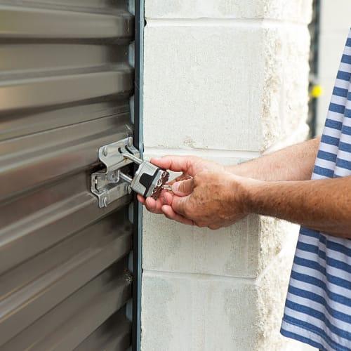 A man unlocking his unit at a Carlsbad Self Storage location