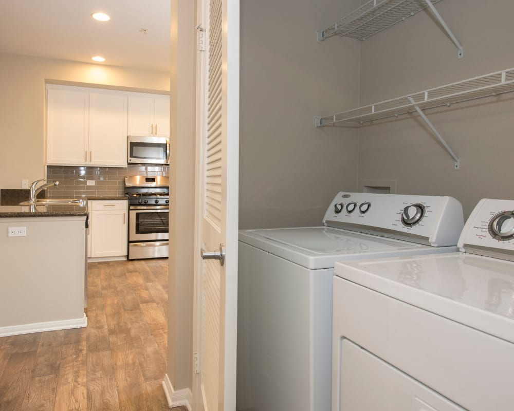 In-home washer and dryer with shelving at Paragon at Old Town in Monrovia, California