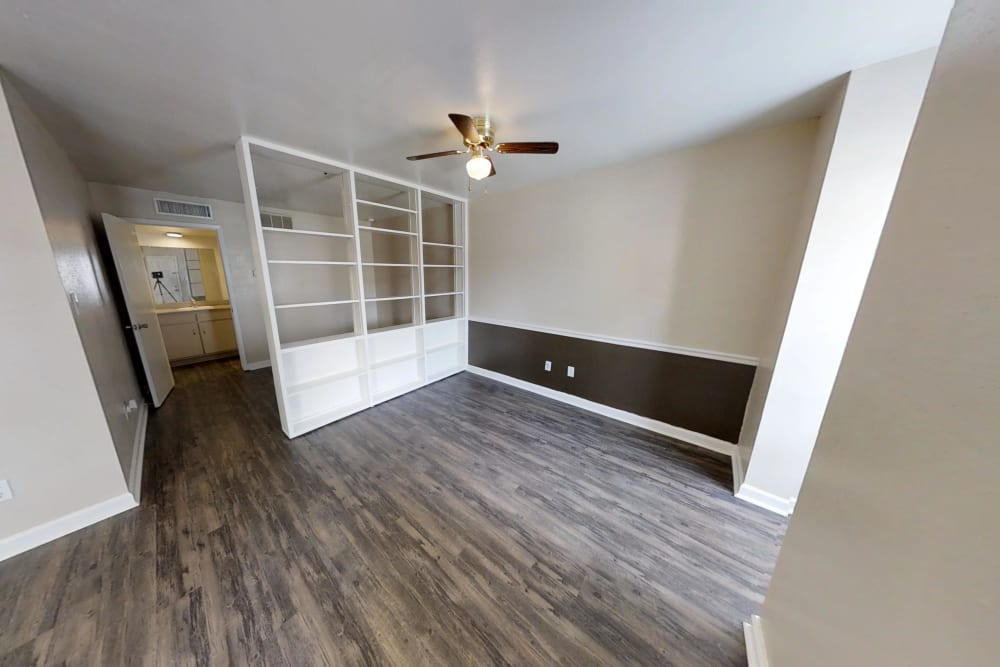 Stunning wood-style flooring at Falls of Maplewood Apartments in Houston, Texas