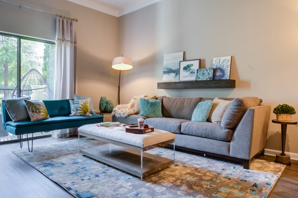 Modern living room at Celsius Apartments in Charlotte, North Carolina managed by Hercules Living.