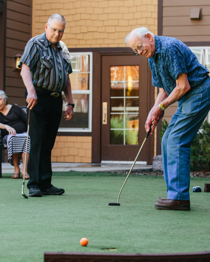 Residents enjoying putting green at The Springs at Missoula in Missoula, Montana