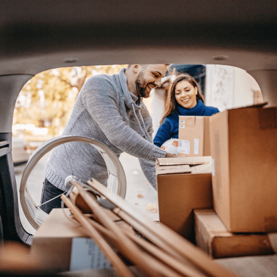 Couple unloading boxes from their car at A-American Self Storage in Buena Park, California