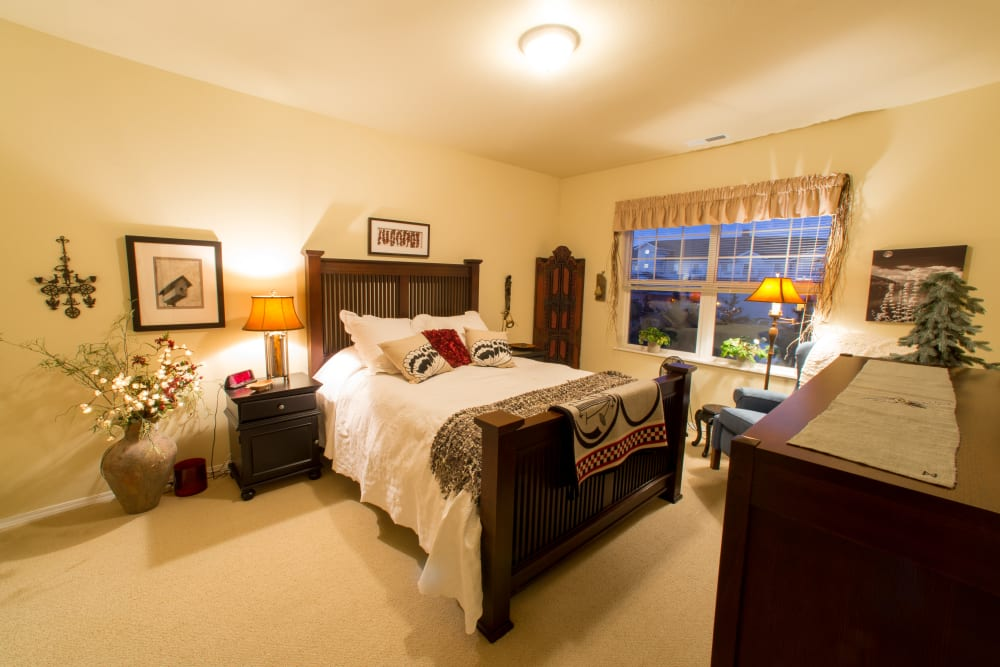 A decorated bedroom at Touchmark at Harwood Groves in Fargo, North Dakota