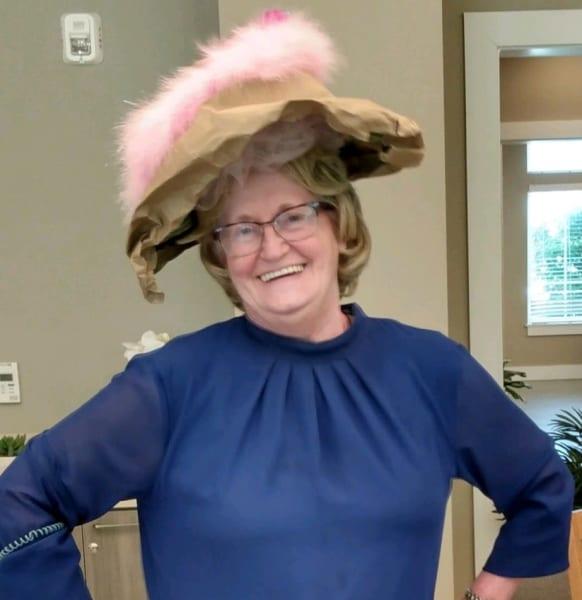 A Carolina Park resident shows off her paper bag hat.