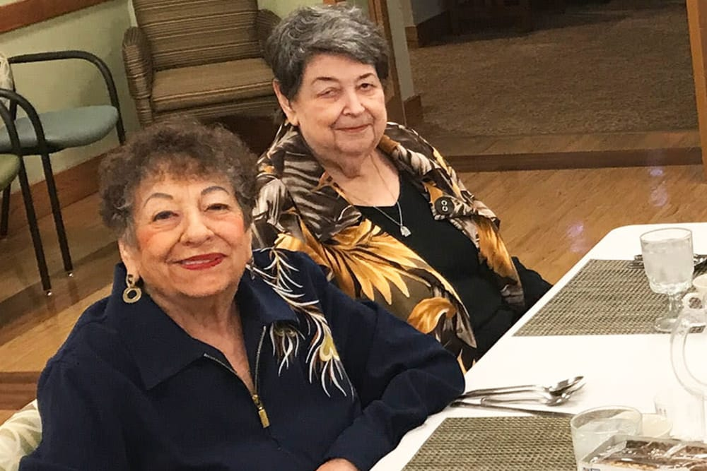 two residents at a dining table