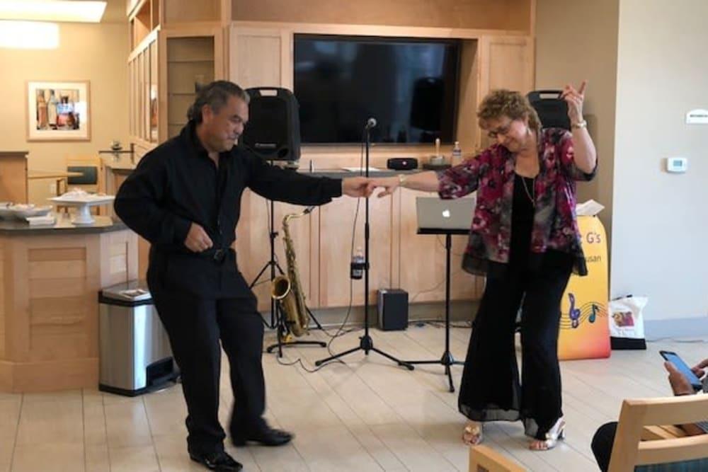 Residents dancing at Merrill Gardens at Rockridge in Oakland, California.