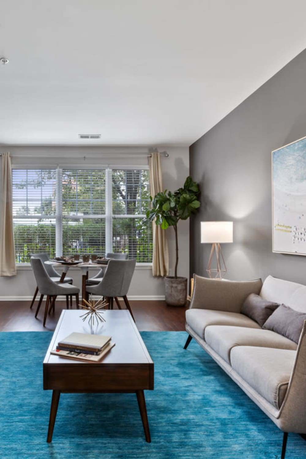 Spacious and modern living room in a model home at Sofi Lyndhurst in Lyndhurst, New Jersey