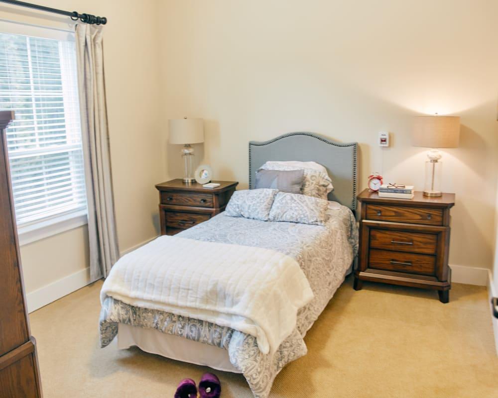 A decorated bedroom at Harmony at West Ashley in Charleston, South Carolina