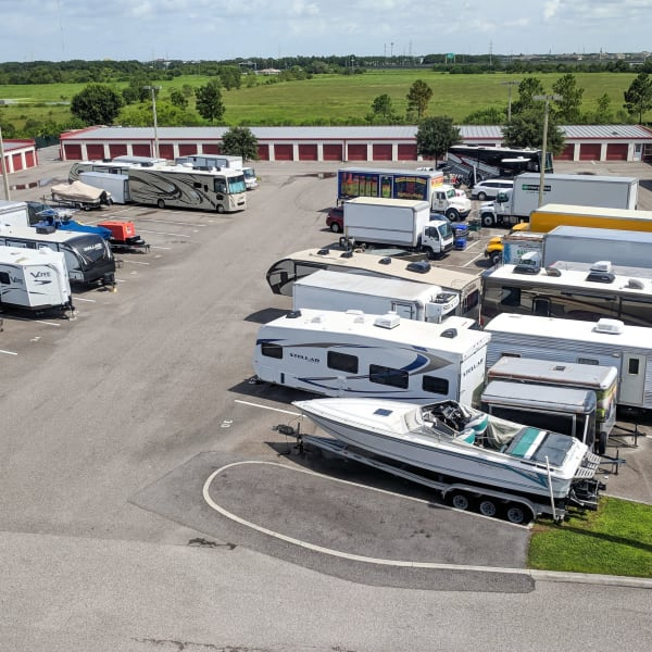 RVs, boats, trucks, and trailers parked at StorQuest Self Storage in Tampa, Florida