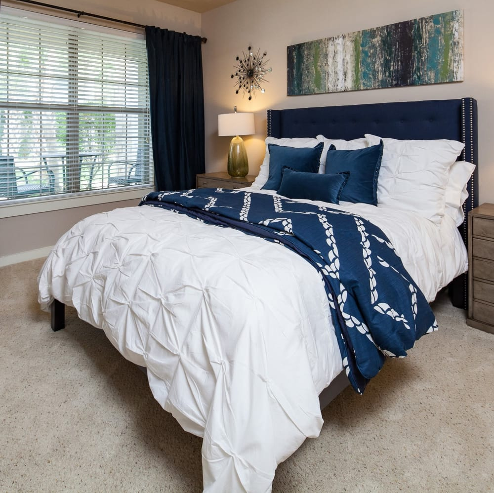 Master bedroom with a ceiling fan at Lakefront Villas in Houston, Texas
