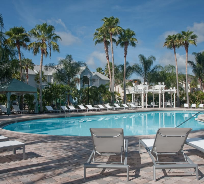 Lounge chairs and cabanas around the pool at Abaco Key in Orlando, Florida