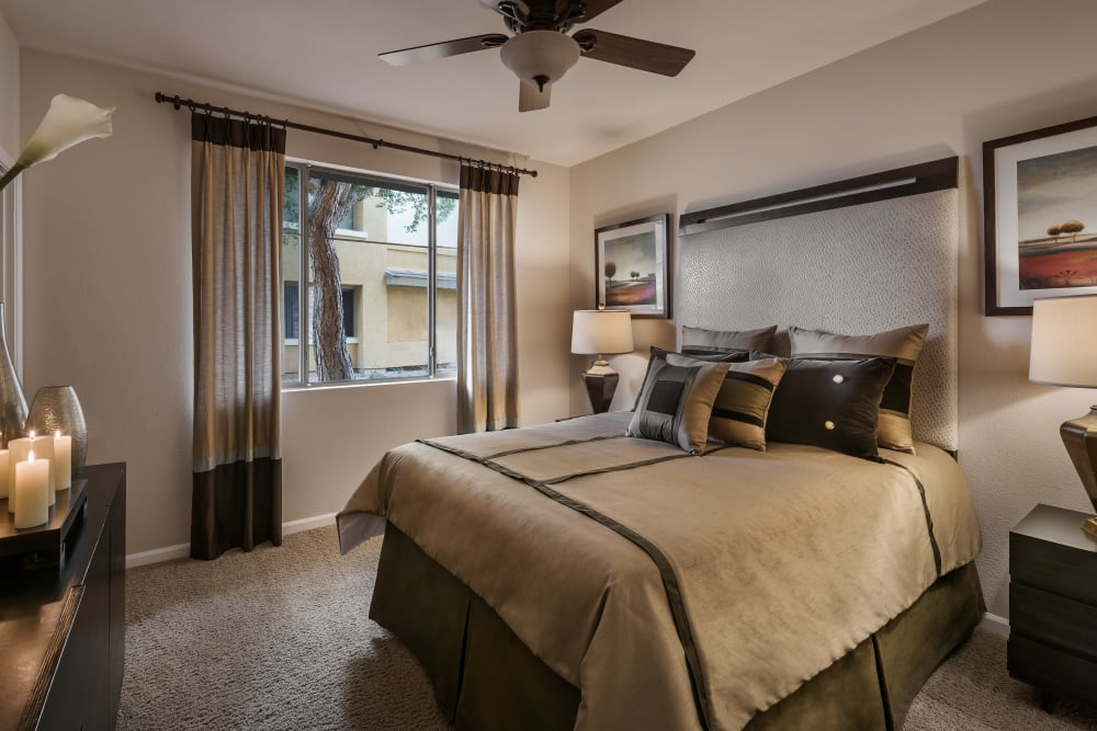 Large master bedroom with ceiling fan and beautiful furnishings in model home at Borrego at Spectrum in Gilbert, Arizona