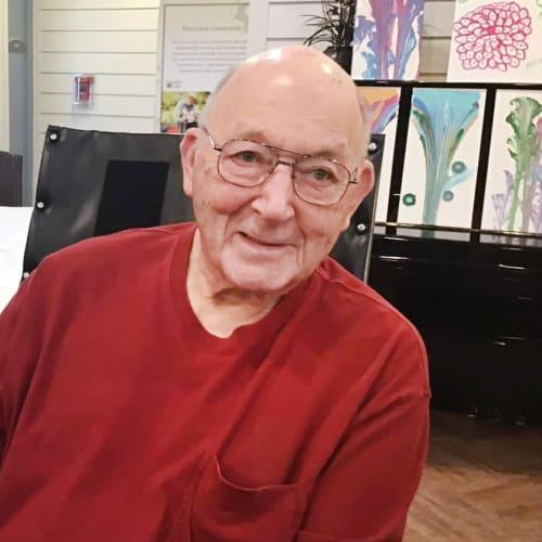 Resident smiling at Oxford Glen Memory Care at Grand Prairie in Grand Prairie, Texas