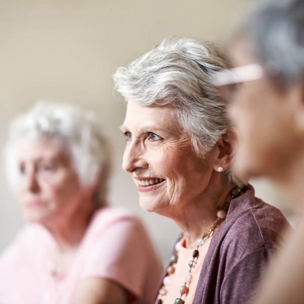 A resident listening to a talk at Pacifica Senior Living Fresno in Fresno, California.
