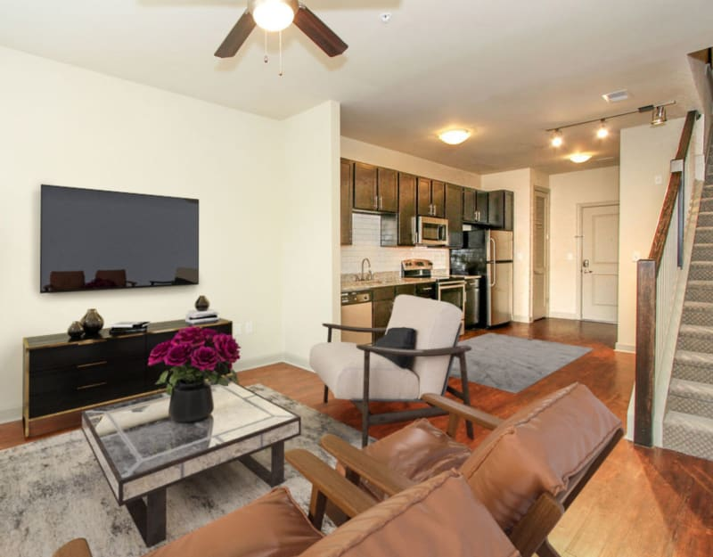 Model living room with view of kitchen at 401 Oberlin in Raleigh, North Carolina