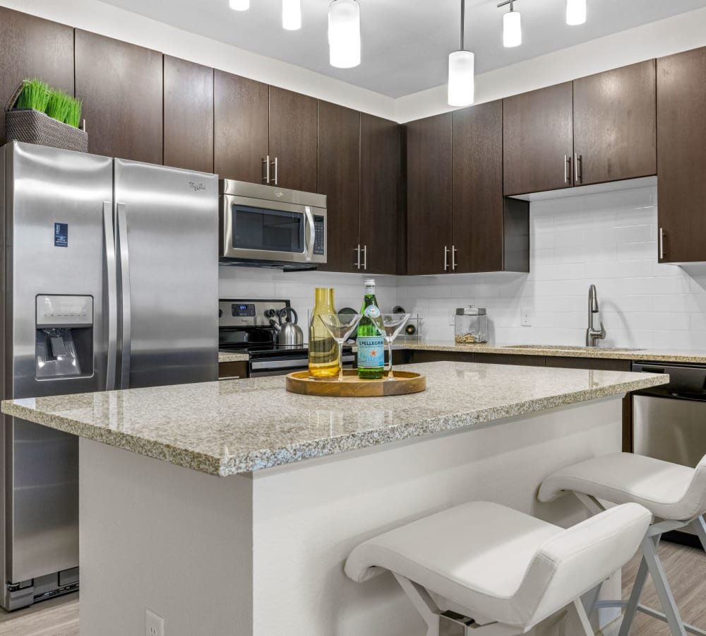 Spacious kitchen with stainless steel appliances and ample counter and storage space at The Parc at Greenwood Village in Greenwood Village, Colorado