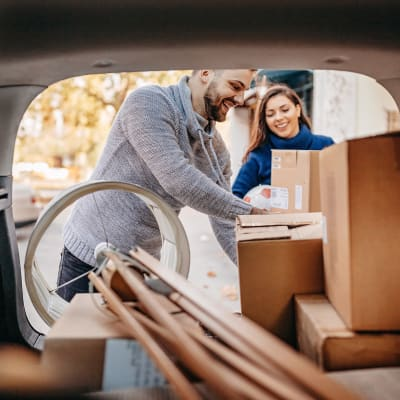 Couple unloading boxes from their car at A-American Self Storage in El Cajon, California