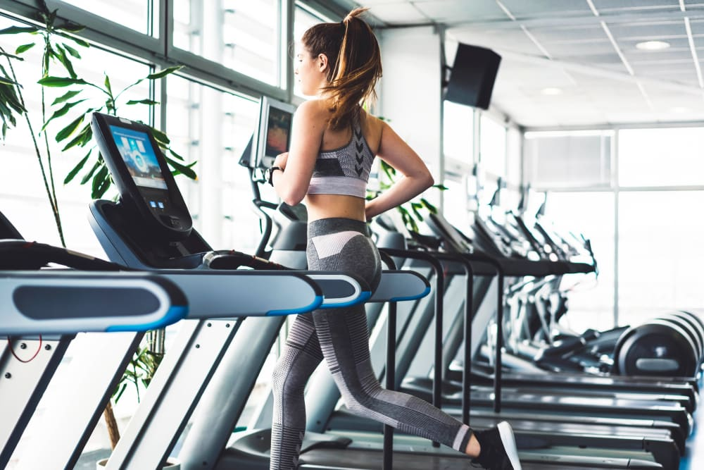 Resident staying in shape in the fitness center at Canyon View in Las Vegas, Nevada